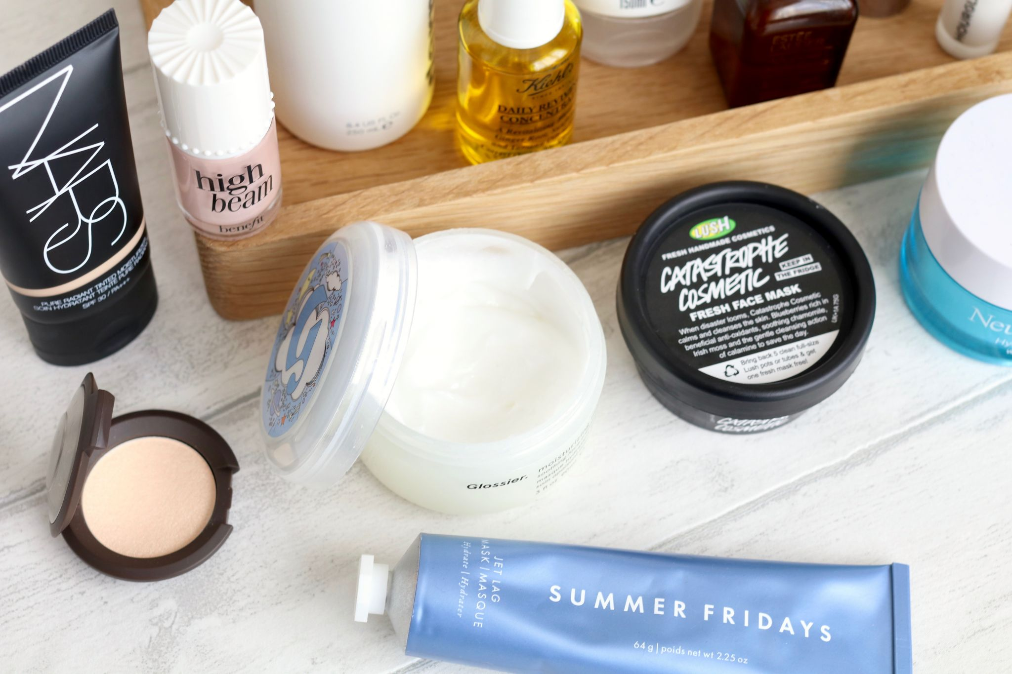 Mistakes to avoid if you have oily skin - Nars tinted moisturiser, Becca opal highlighter, Summer Fridays jet lag mask, Glossier mositure moon, Benefit high beam, Lush Catastrophe cosmetic