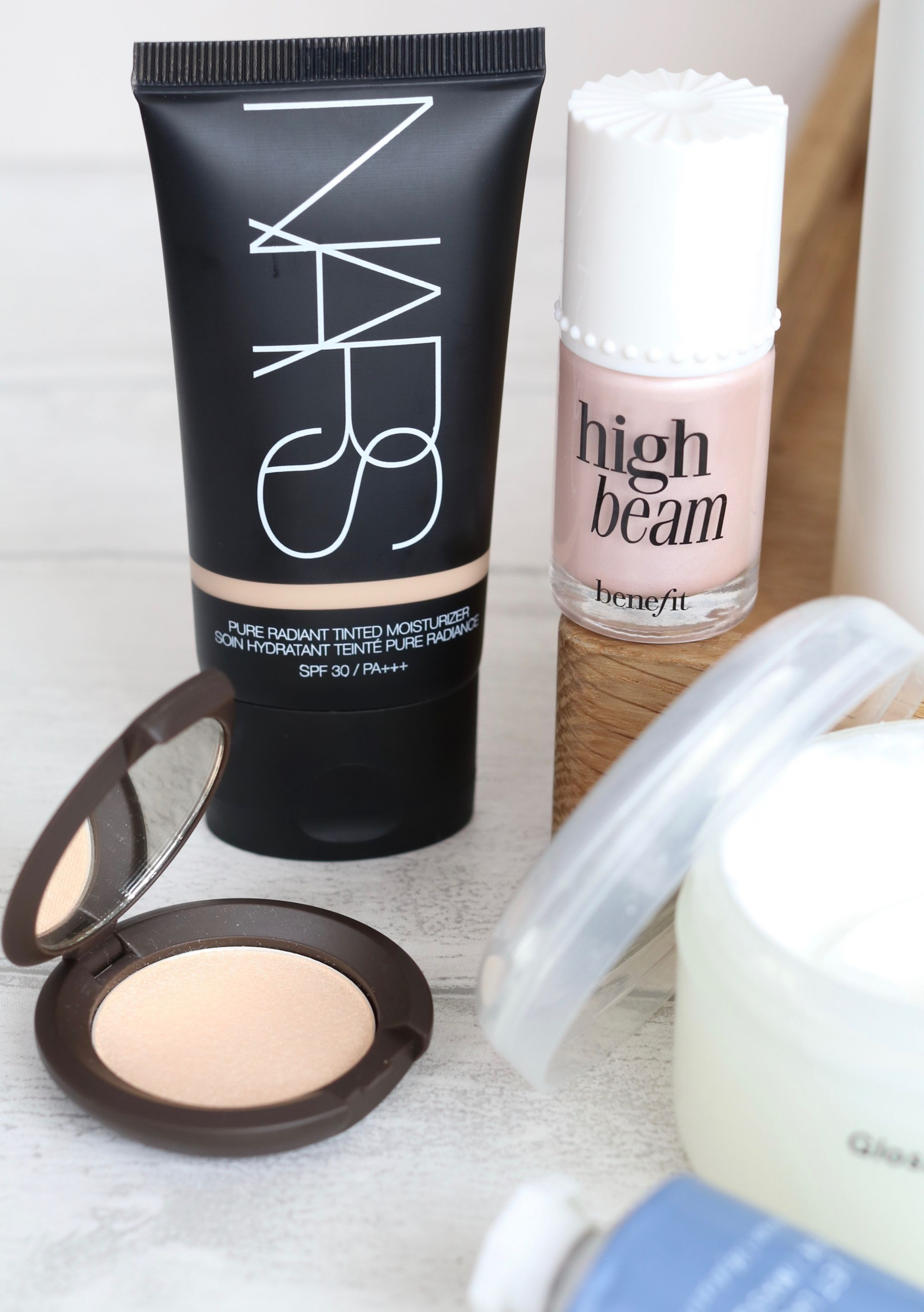 Mistakes to avoid if you have oily skin - Nars tinted moisturiser, Becca opal highlighter, Summer Fridays jet lag mask, Glossier mositure moon, Benefit high beam