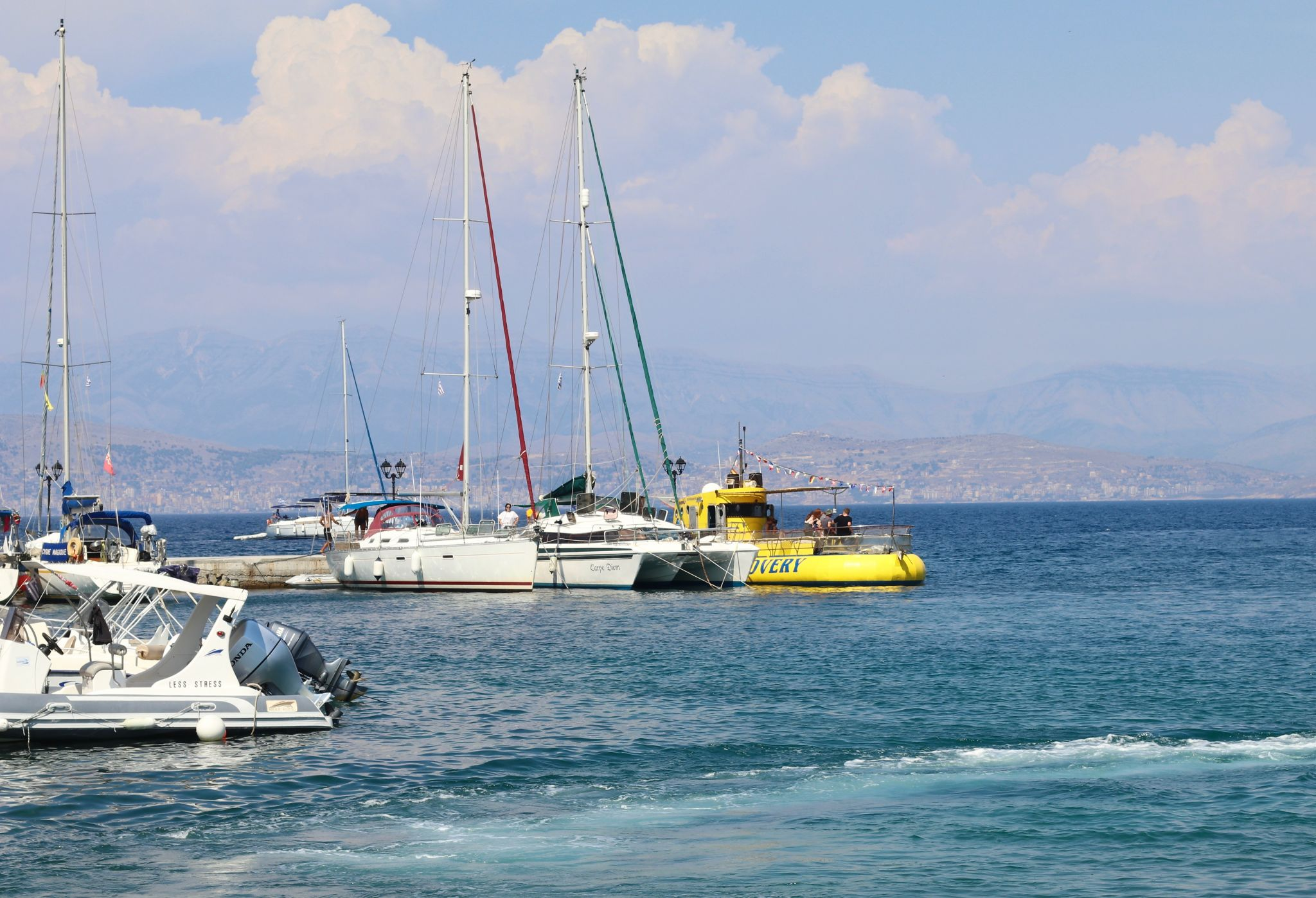 Kassiopi boats in harbour Yellow Submarine sea discovery | Corfu travel guide