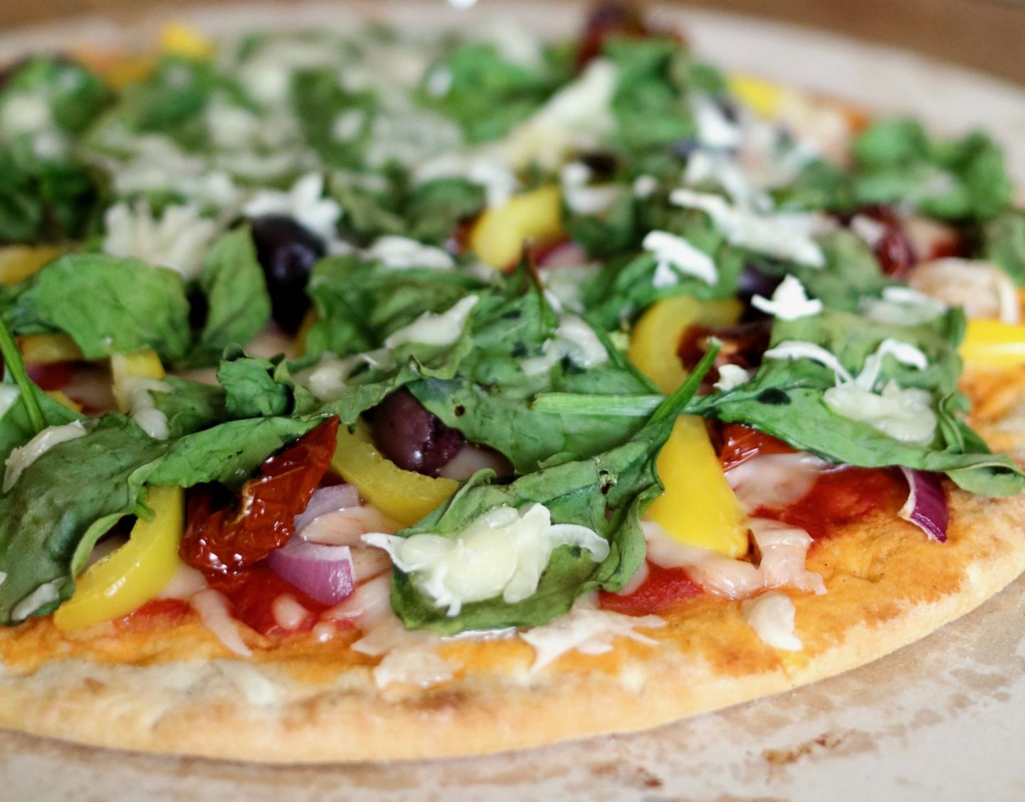 Create Your Own Vegan Pizza - close up of vegan pizza.